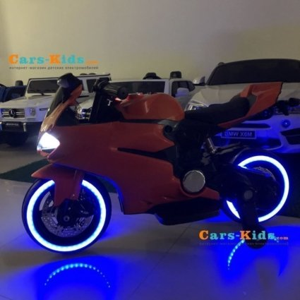 Детский электромотоцикл Ducati 12V- FT-1628 оранжевый (колеса резина, сиденье кожа, музыка, страховочные колеса, ручка газа)